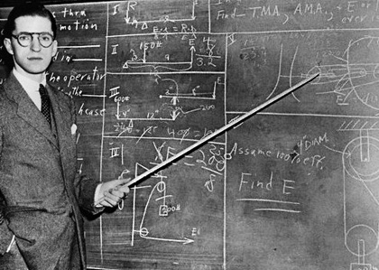 1930 --- 1930s Man Teacher Looking At Camera With Pointer At Blackboard --- Image by © H. Armstrong Roberts/ClassicStock/Corbis